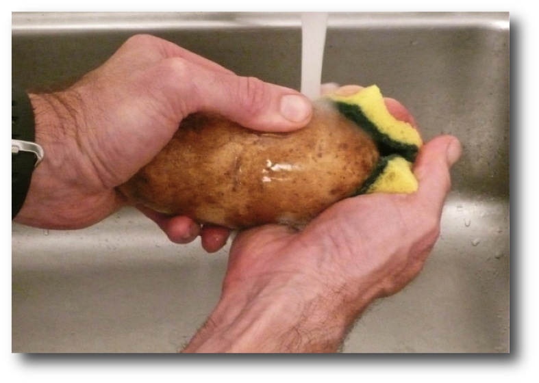 Cleaning potato skin with an abrasive sponge