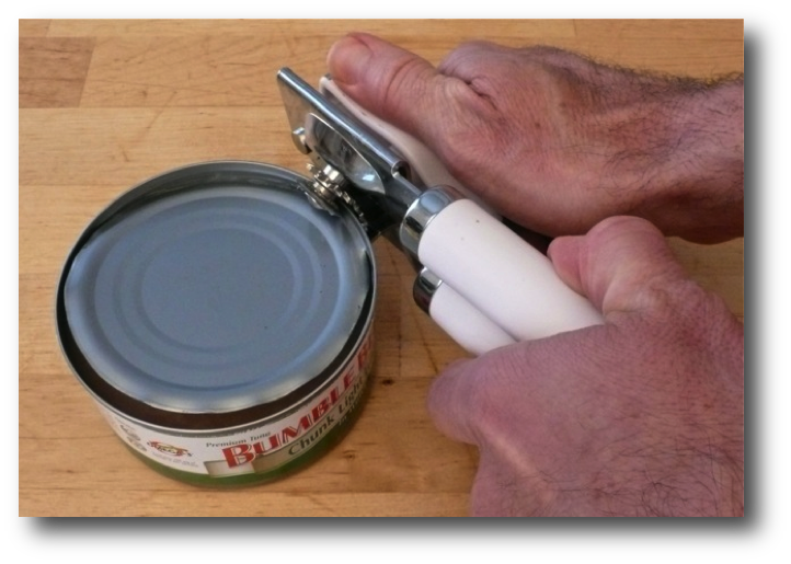 Opening a tuna can with a can opener